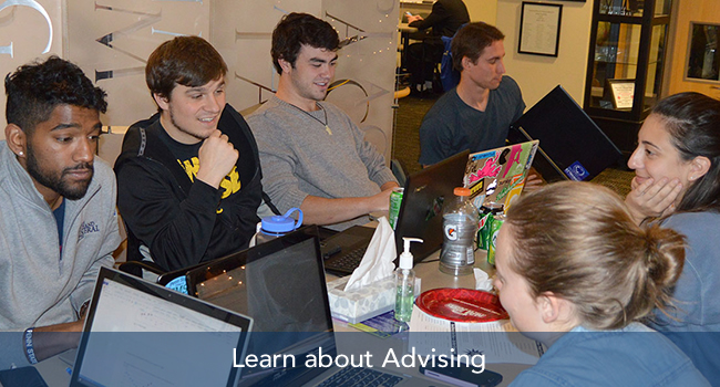 Students discussing advising