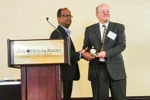 Kleit receiving award