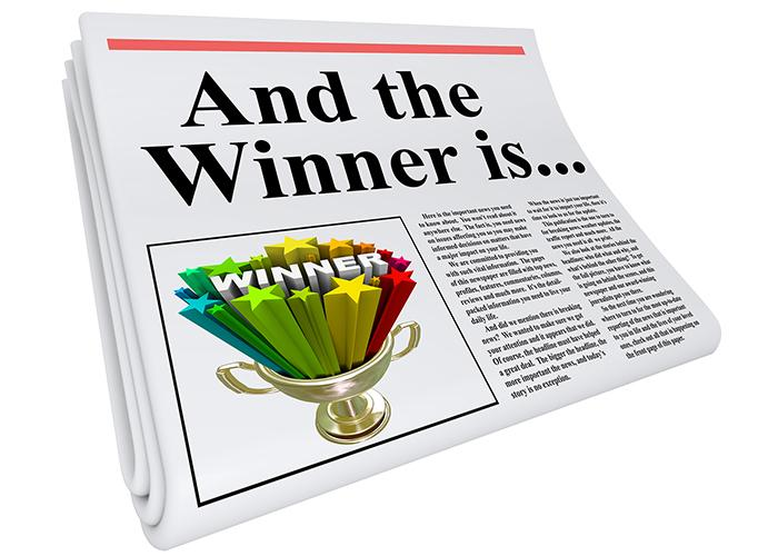 "newspaper image with the words, ""And the winner is..."""