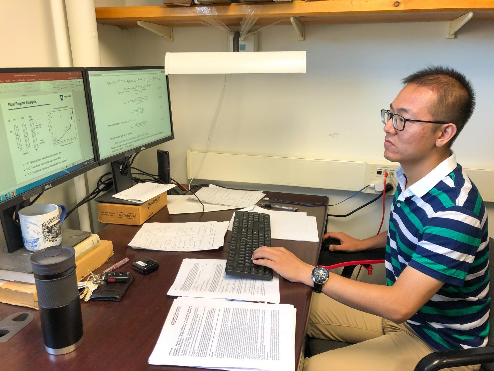 Fengyuan Zhang doing research